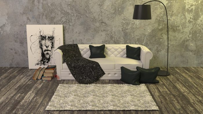 un salon decorado con suelo de madera oscura